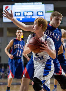 BANGOR, ME -- 02/20/2017 -- Central Aroostook's Ben Thomas (front) goes to shoot past Jonesport-Beals's Austin Grant during their Class D quarterfinal game at the Cross Insurance Center in Bangor on Monday afternoon. Micky Bedell   BDN