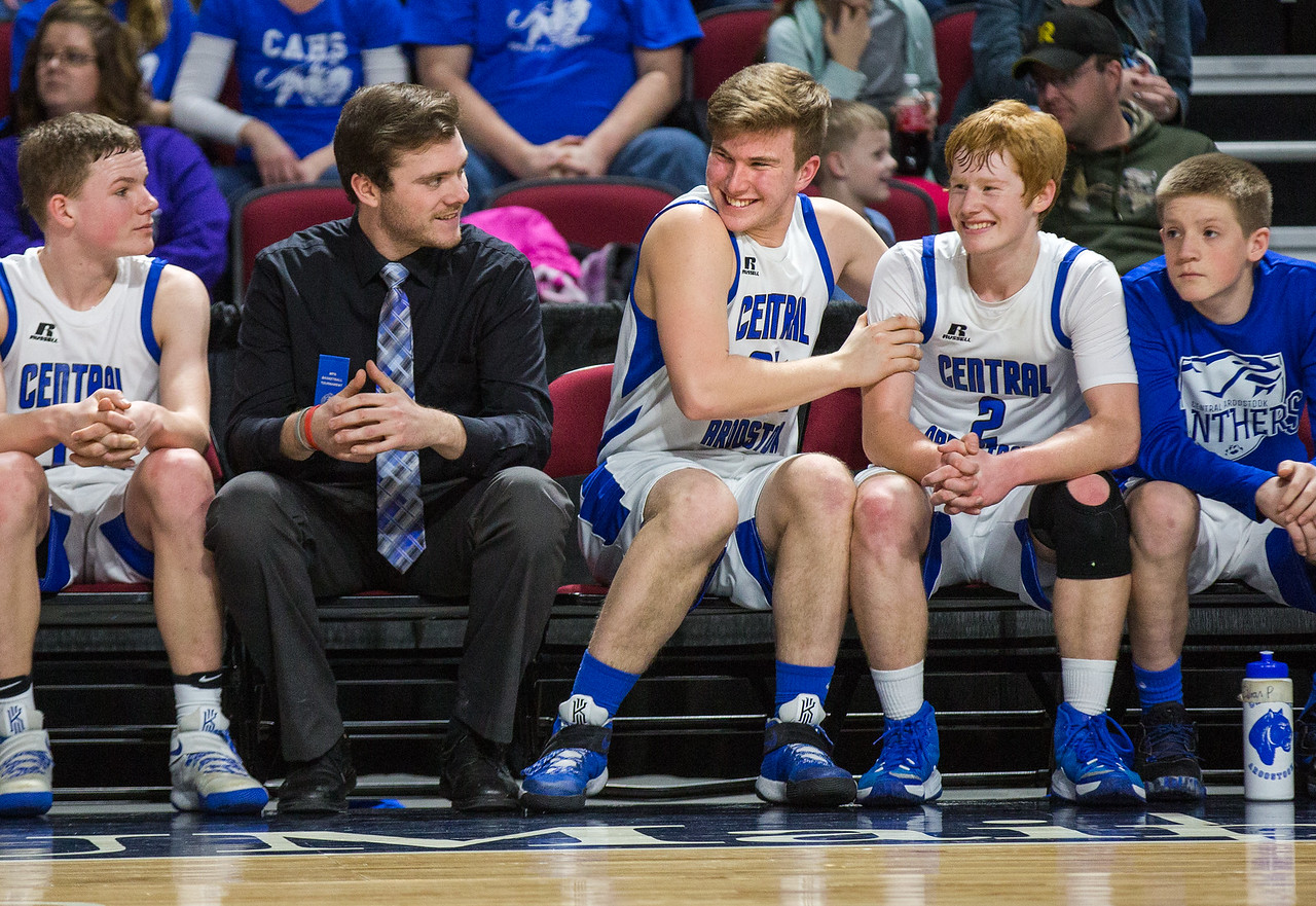 Central Aroostook's Colby Kingsbury (center) shakes teammate Ben Thomas while watching from the bench during their Class D quarterfinal game at the Cross Insurance Center in Bangor on Monday afternoon. Micky Bedell   BDN
