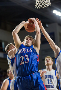 BANGOR, ME -- 02/20/2017 -- Jonesport-Beals' Austin Grant (center) grips a rebound during their Class D quarterfinal game against Central Aroostook at the Cross Insurance Center in Bangor on Monday afternoon. Micky Bedell | BDN