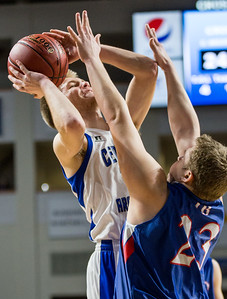 BANGOR, ME -- 02/20/2017 -- Central Aroostook's Zach Crouch (left) goes to pass over Jonesport-Beals's Austin Grant during their Class D quarterfinal game at the Cross Insurance Center in Bangor on Monday afternoon. Micky Bedell   BDN