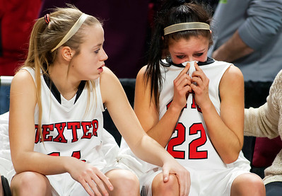 BANGOR, Maine -- 03/04/2017 -- Dexter's Kaylee Deering (right) is comforted by teammate Dexter's Danielle Cummings after being defeated by Monmouth during their Class C girls basketball state championship at the Cross Insurance Center in Bangor Saturday. Ashley L. Conti | BDN