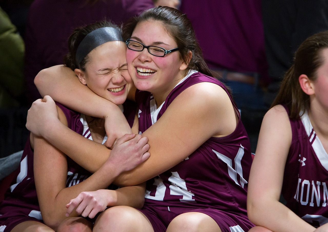 BANGOR, Maine -- 03/04/2017 -- Monmouth's Libby A. Clement (left) embraces Monmouth's Destiny Clough after defeating Dexter during their Class C girls basketball state championship at the Cross Insurance Center in Bangor Saturday. Ashley L. Conti   BDN