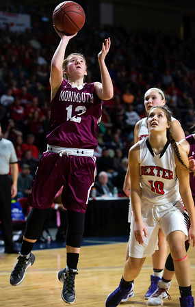 BANGOR, Maine -- 03/04/2017 -- Monmouth's Abbey Allen (left) goes up for two past Dexter's Rebecca Batron during their Class C girls basketball state championship at the Cross Insurance Center in Bangor Saturday. Ashley L. Conti | BDN