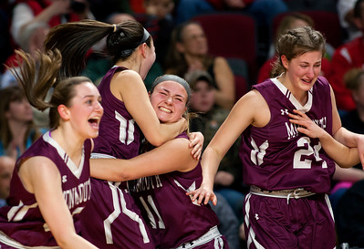 BANGOR, Maine -- 03/04/2017 -- Monmouth celebrates after defeating Dexter during their Class C girls basketball state championship at the Cross Insurance Center in Bangor Saturday. Ashley L. Conti | BDN
