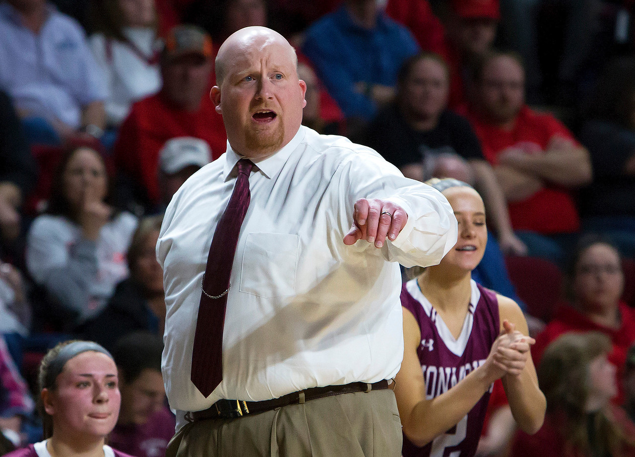 BANGOR, Maine -- 03/04/2017 -- Monmouth head coach Scott Wing yells instructions to his team during their Class C girls basketball state championship against Dexter at the Cross Insurance Center in Bangor Saturday. Ashley L. Conti | BDN