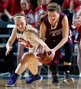BANGOR, Maine -- 03/04/2017 -- Dexter's Kayli Cunningham (left) and Monmouth's Abbey Allen battle for a loose ball during their Class C girls basketball state championship at the Cross Insurance Center in Bangor Saturday. Ashley L. Conti | BDN