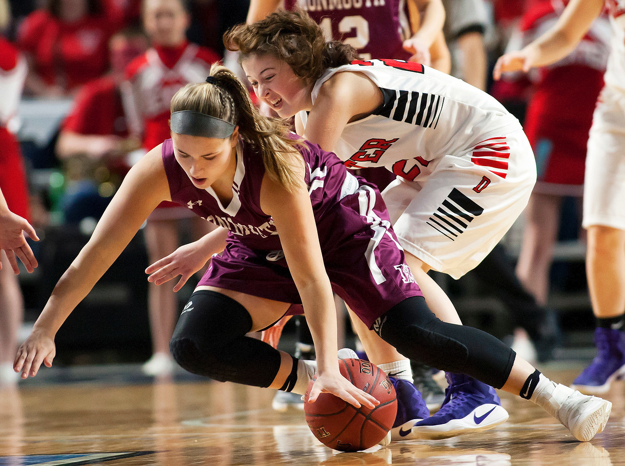 BANGOR, Maine -- 03/04/2017 -- Monmouth's Hannah Anderson (left) and Dexter's Ashley Reynolds battle for  a loose ball during their Class C girls basketball state championship at the Cross Insurance Center in Bangor Saturday. Ashley L. Conti   BDN