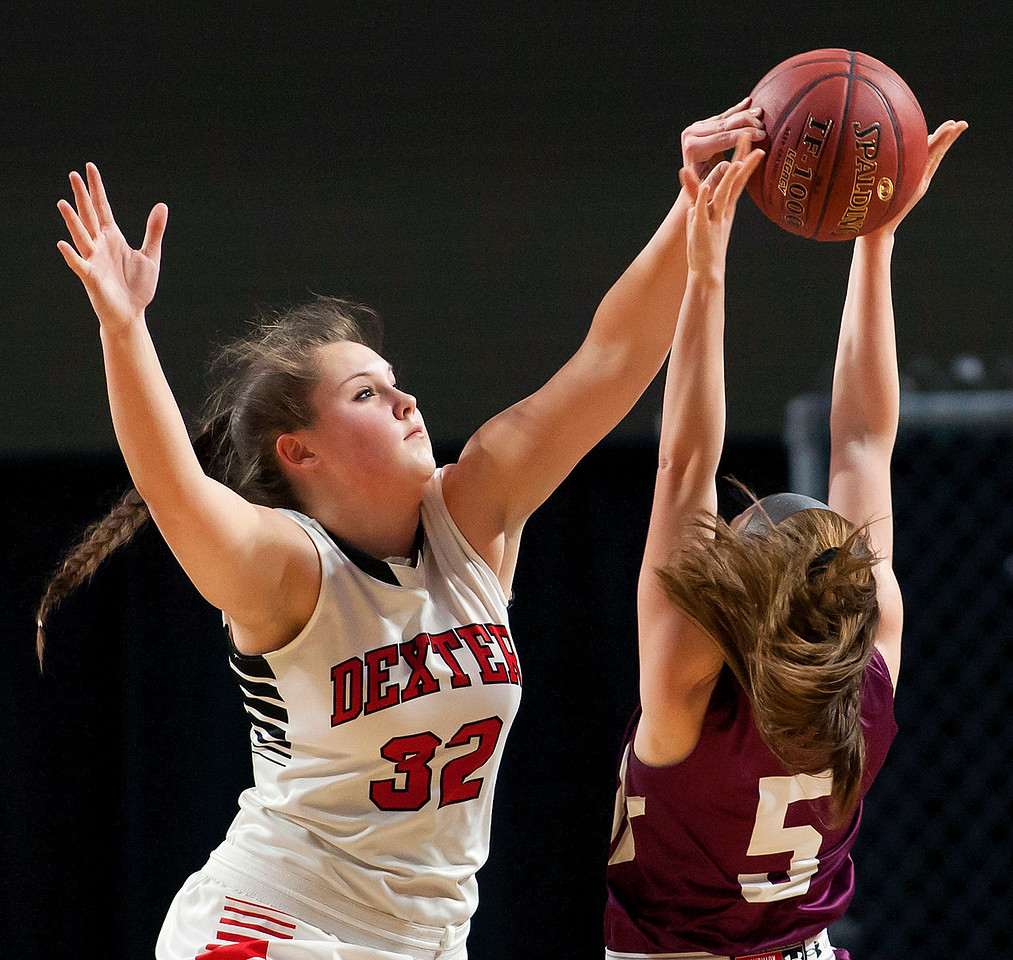 BANGOR, Maine -- 03/04/2017 -- Dexter's Megan Peach (left) blocks a shot from Monmouth's Emily Grandahl during their Class C girls basketball state championship at the Cross Insurance Center in Bangor Saturday. Ashley L. Conti | BDN