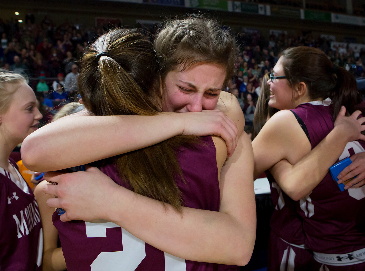BANGOR, Maine -- 03/04/2017 -- Monmouth's Abby Ferland (left) embraces Monmouth's Kaeti Butterfield after defeating Dexter during their Class C girls basketball state championship at the Cross Insurance Center in Bangor Saturday. Ashley L. Conti | BDN