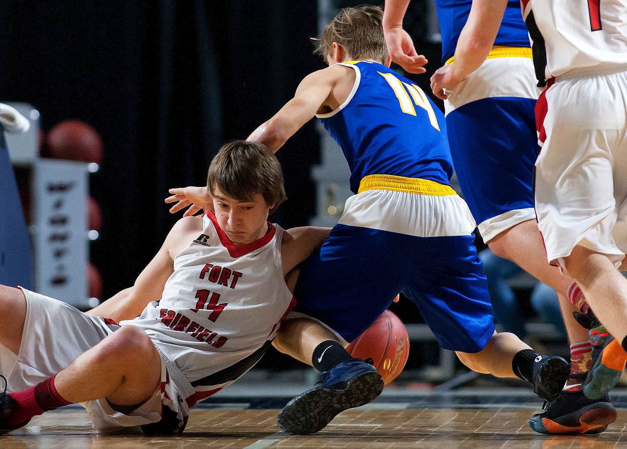 BANGOR, Maine -- 02/21/2017 -- Fort Fairfield's Christopher Giberson (left) fouls Piscataquis' Dillon Drew while going for a rebound during their Class C boys basketball quarterfinal game at the Cross Insurance Center in Bangor Tuesday. Ashley L. Conti   BDN