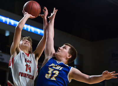 BANGOR, Maine -- 02/21/2017 -- Fort Fairfield's Christopher Giberson (left) is fouled by Piscataquis' Jarrod White during their Class C boys basketball quarterfinal game at the Cross Insurance Center in Bangor Tuesday. Ashley L. Conti | BDN