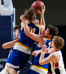 BANGOR, Maine -- 02/21/2017 -- Fort Fairfield's Christopher Giberson (left) fouls Piscataquis' Dillon Drew while going for a rebound during their Class C boys basketball quarterfinal game at the Cross Insurance Center in Bangor Tuesday. Ashley L. Conti | BDN