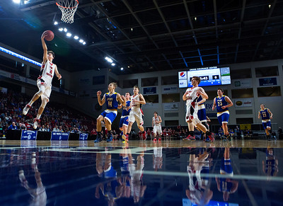 BANGOR, Maine -- 02/21/2017 -- Fort Fairfield's Isaac Cyr (left) goes up for a layup past Piscataquis' Dillon Drew during their Class C boys basketball quarterfinal game at the Cross Insurance Center in Bangor Tuesday. Ashley L. Conti | BDN