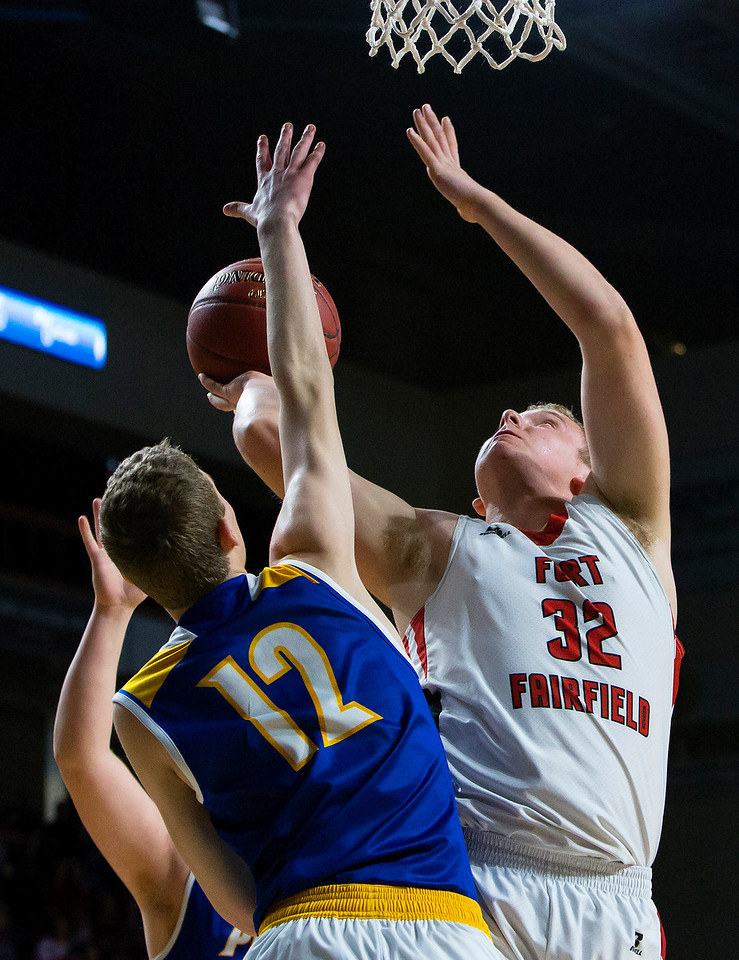BANGOR, Maine -- 02/21/2017 -- Fort Fairfield's Jared Harvey (right) puts up a shot past Piscataquis' Cameron Kane during their Class C boys basketball quarterfinal game at the Cross Insurance Center in Bangor Tuesday. Ashley L. Conti   BDN