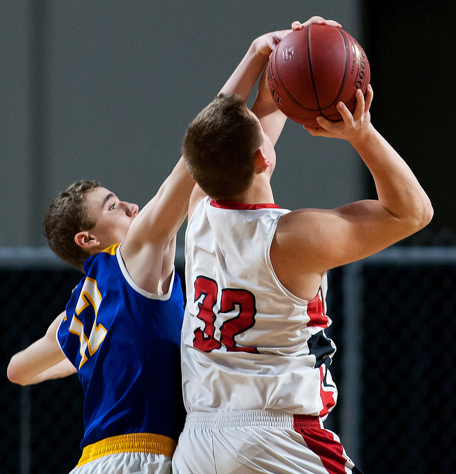 BANGOR, Maine -- 02/21/2017 -- Piscataquis' Cameron Kane (left) fouls Fort Fairfield's Jared Harvey during their Class C boys basketball quarterfinal game at the Cross Insurance Center in Bangor Tuesday. Ashley L. Conti | BDN
