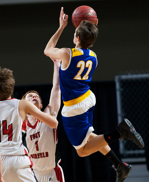 BANGOR, Maine -- 02/21/2017 -- Piscataquis' Bryce Gilbert (right) floats up a shot past Fort Fairfield's Ryan Player during their Class C boys basketball quarterfinal game at the Cross Insurance Center in Bangor Tuesday. Ashley L. Conti | BDN