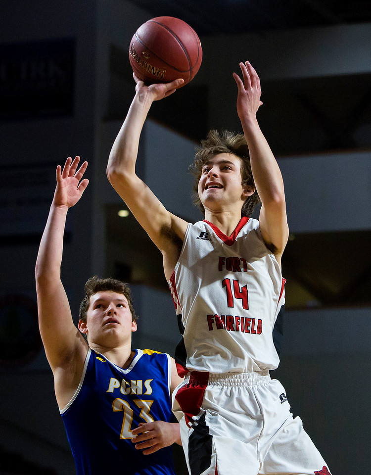 BANGOR, Maine -- 02/21/2017 -- Fort Fairfield's Christopher Giberson (right) fades a shot past Piscataquis' Damyan True during their Class C boys basketball quarterfinal game at the Cross Insurance Center in Bangor Tuesday. Ashley L. Conti | BDN