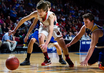 BANGOR, Maine -- 02/21/2017 -- Fort Fairfield's Christopher Giberson (left) tries to save a loose ball from going out of bounds against Piscataquis' Jarrod White during their Class C boys basketball quarterfinal game at the Cross Insurance Center in Bangor Tuesday. Ashley L. Conti | BDN