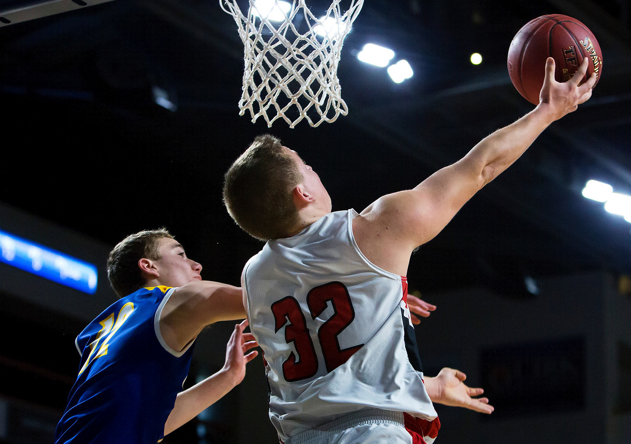 BANGOR, Maine -- 02/21/2017 -- Fort Fairfield's Jared Harvey (right) goes up for a layup past Piscataquis' Cameron Kane during their Class C boys basketball quarterfinal game at the Cross Insurance Center in Bangor Tuesday. Ashley L. Conti   BDN