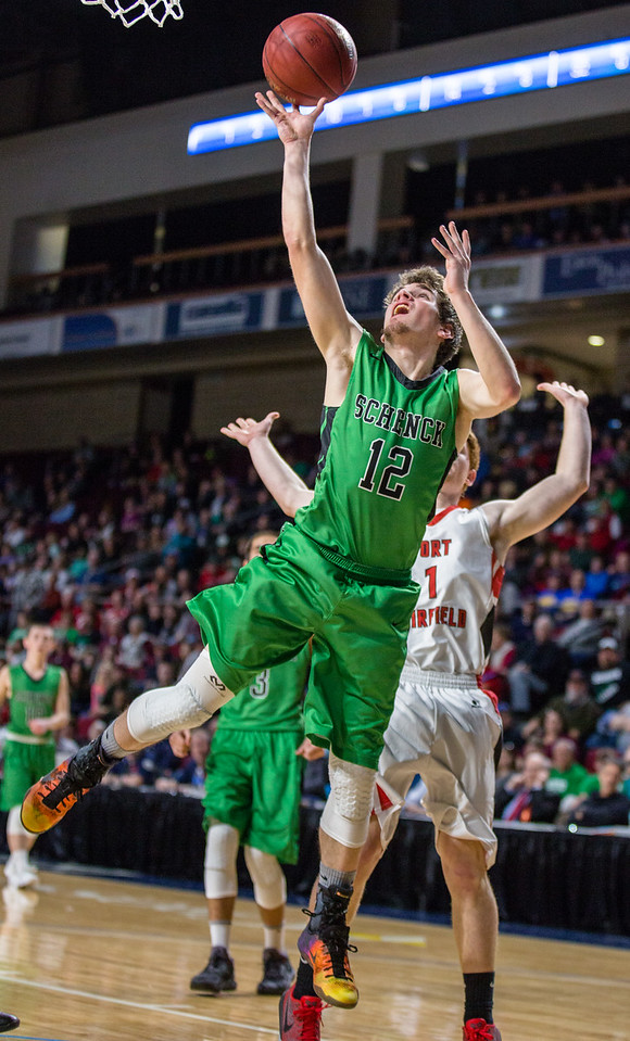 BANGOR, MAINE -- 02/24/2017 -- Schenck's Christopher J. King jumps and reaches to shoot during their class C boys semifinal game against Fort Fairfield at the Cross Insurance Center on Friday afternoon. Micky Bedell | BDN
