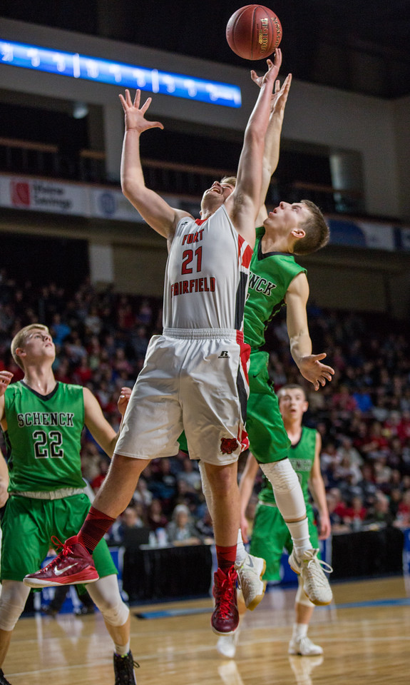 BANGOR, MAINE -- 02/24/2017 -- Fort Fairfield's Landen Kinney (front) battles for a rebound against Schenck's Dylan Danforth (behind) while Justin Thompson looks on (left) during their class C boys semifinal game at the Cross Insurance Center on Friday afternoon. Micky Bedell   BDN