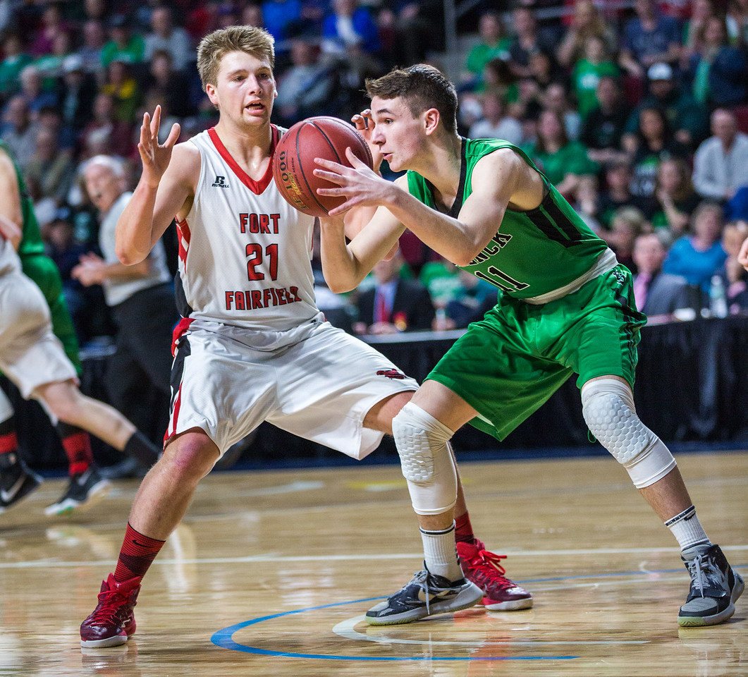 BANGOR, MAINE -- 02/24/2017 -- Fort Fairfield's Landen Kinney (left) defends Schenck's Colby Hannan during their class C boys semifinal game at the Cross Insurance Center on Friday afternoon. Micky Bedell   BDN