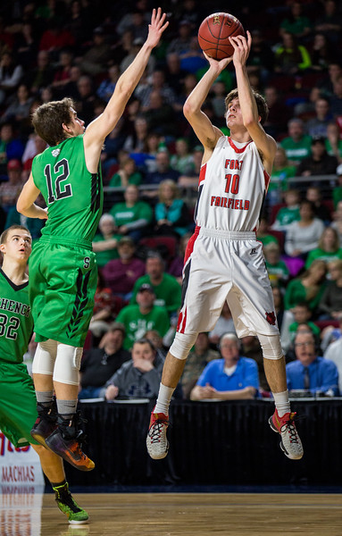 BANGOR, MAINE -- 02/24/2017 -- Fort Fairfield's Isaac Cyr jumps to shoot as Schenck's Christopher J. King jumps to block during their class C boys semifinal game at the Cross Insurance Center on Friday afternoon. Micky Bedell | BDN