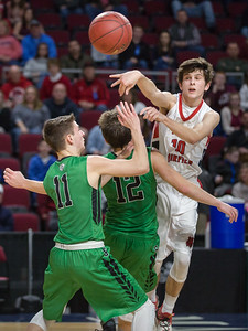 BANGOR, MAINE -- 02/24/2017 -- Fort Fairfield's Isaac Cyr (back right) passes over the heads of Schenck defensemen Christopher J. King (center) and Colby Hannan during their class C boys semifinal game at the Cross Insurance Center on Friday afternoon. Micky Bedell | BDN