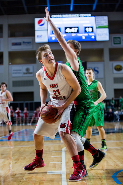 BANGOR, MAINE -- 02/24/2017 -- Fort Fairfield's Landen Kinney (left) looks for a shot as Schenck's Erick Green tries to block during their class C boys semifinal game at the Cross Insurance Center on Friday afternoon. Micky Bedell | BDN