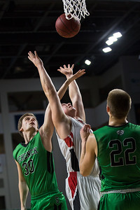 BANGOR, MAINE -- 02/24/2017 -- Fort Fairfield's Jared Harvey (center) reaches for a rebound as Schenck's Erick Green (left) reaches out to stop him and Justin Thompson looks on during their class C boys semifinal game at the Cross Insurance Center on Friday afternoon. Micky Bedell | BDN