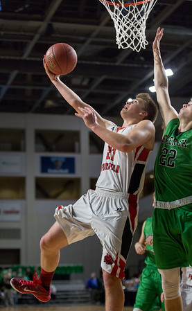 BANGOR, MAINE -- 02/24/2017 -- Fort Fairfield's Landen Kinney (left) goes for the shot as Schenck's Justin Thompson reaches to block during their class C boys semifinal game at the Cross Insurance Center on Friday afternoon. Micky Bedell   BDN