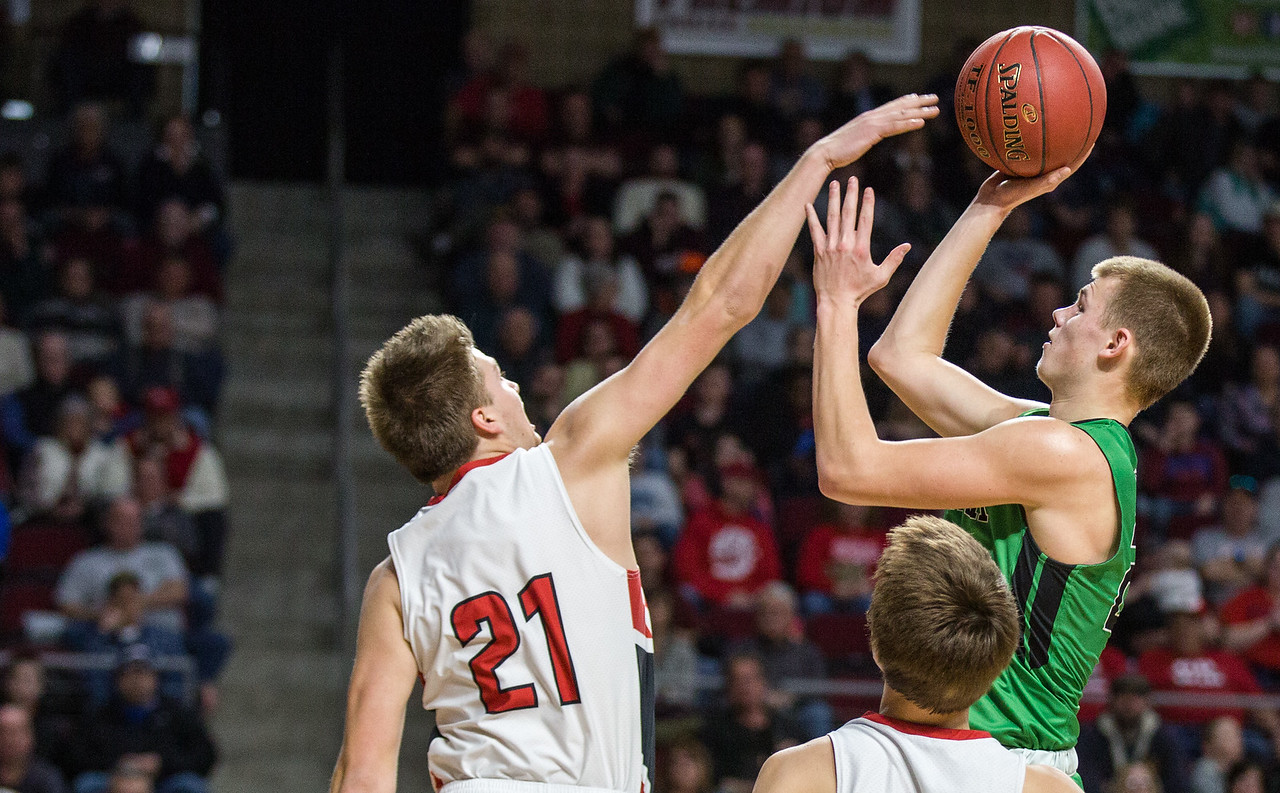 BANGOR, MAINE -- 02/24/2017 -- Fort Fairfield's Landen Kinney (left) reaches to block Schenck's Justin Thompson as he goes to shoot during their class C boys semifinal game at the Cross Insurance Center on Friday afternoon. Micky Bedell | BDN