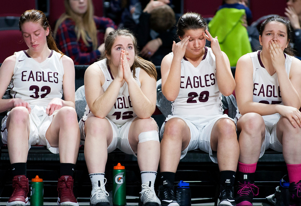 BANGOR, Maine -- 02/25/2017 -- George Stevens Academy sits dejected as they realize they will be defeated by Dexter during their Class C girls basketball championship game at the Cross Insurance Center in Bangor Saturday. Ashley L. Conti | BDN