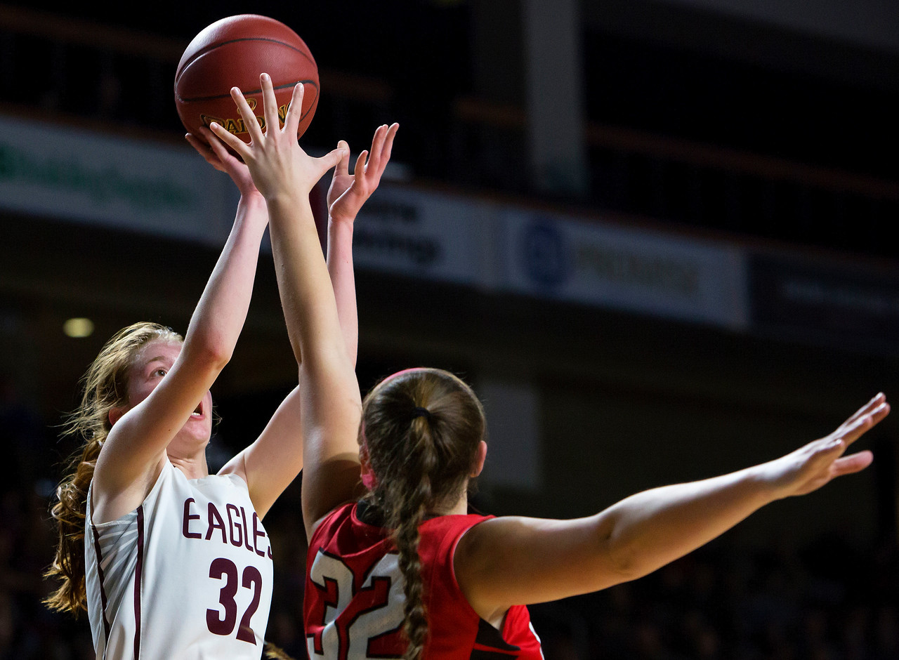 BANGOR, Maine -- 02/25/2017 -- George Stevens Academy's Mazie Smallidge (left) puts up a shot past Dexter's Megan Peach during their Class C girls basketball championship game at the Cross Insurance Center in Bangor Saturday. Ashley L. Conti   BDN