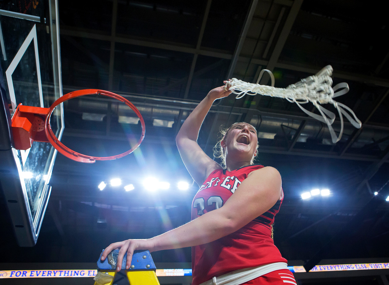BANGOR, Maine -- 02/25/2017 -- Dexter's Megan Peach swings the net around her head after defeating George Stevens Academy during their Class C girls basketball championship game at the Cross Insurance Center in Bangor Saturday. Ashley L. Conti | BDN