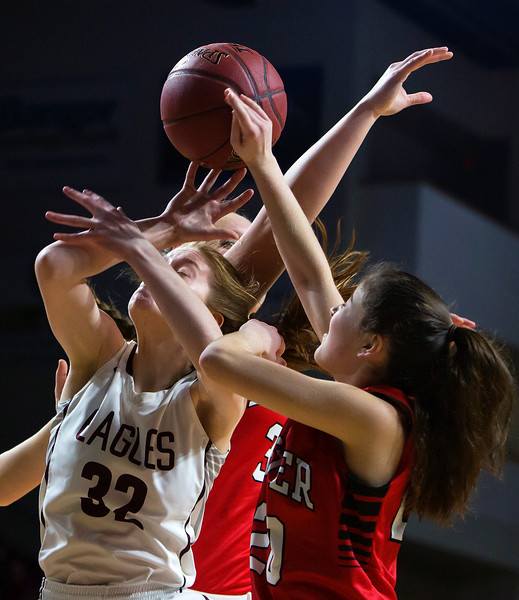 BANGOR, Maine -- 02/25/2017 -- George Stevens Academy's Mazie Smallidge (left) and Dexter's Ashley Reynolds battle for a rebound during their Class C girls basketball championship game at the Cross Insurance Center in Bangor Saturday. Ashley L. Conti | BDN