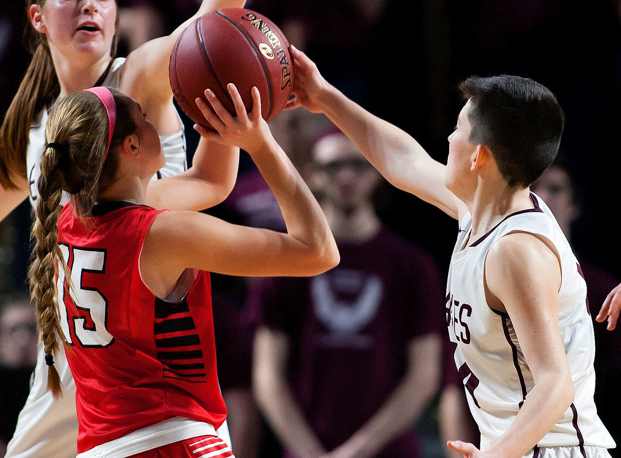 BANGOR, Maine -- 02/25/2017 -- George Stevens Academy's Dawn Hutchinson (right) blocks a shot from Dexter's Kaitlyn Webber during their Class C girls basketball championship game at the Cross Insurance Center in Bangor Saturday. Ashley L. Conti   BDN