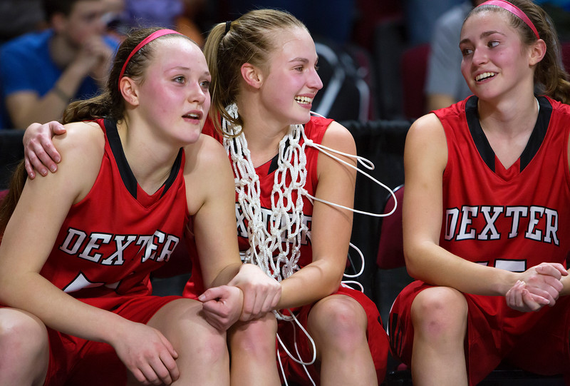 BANGOR, Maine -- 02/25/2017 -- Dexter's Kayli Cunningham (left) and Dexter's Abigail Webber (center) celebrate after defeating George Stevens Academy during their Class C girls basketball championship game at the Cross Insurance Center in Bangor Saturday. Ashley L. Conti | BDN