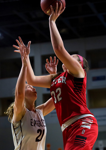 BANGOR, Maine -- 02/25/2017 -- Dexter's Megan Peach (right) goes up for two past George Stevens Academy's Morgan Dauk during their Class C girls basketball championship game at the Cross Insurance Center in Bangor Saturday. Ashley L. Conti | BDN