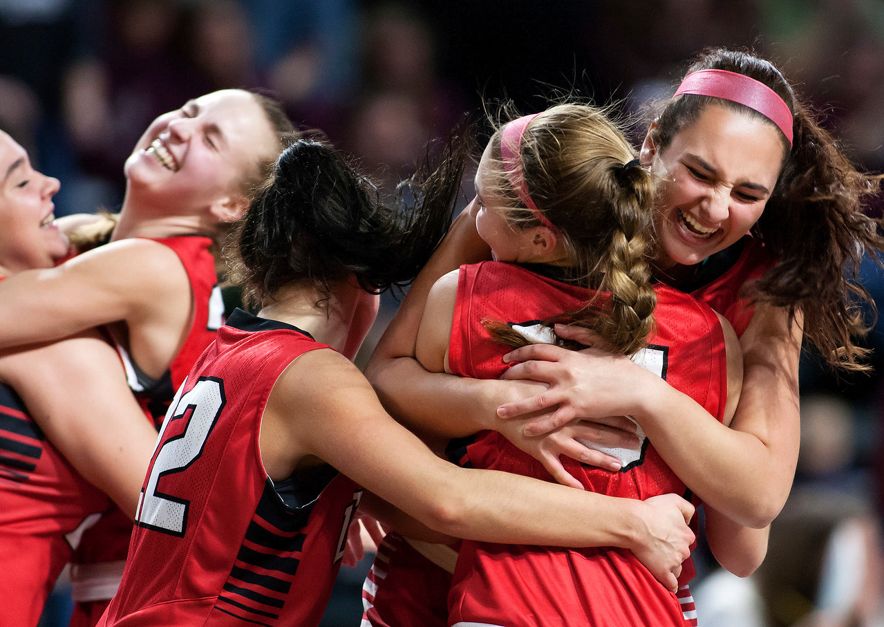 BANGOR, Maine -- 02/25/2017 -- Dexter celebrates after defeating George Stevens Academy during their Class C girls basketball championship game at the Cross Insurance Center in Bangor Saturday. Ashley L. Conti | BDN