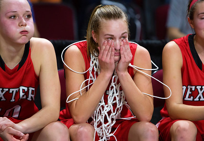 BANGOR, Maine -- 02/25/2017 -- Dexter's Abigail Webber (center) wipes happy tears from her face after defeating George Stevens Academy during their Class C girls basketball championship game at the Cross Insurance Center in Bangor Saturday. Ashley L. Conti | BDN