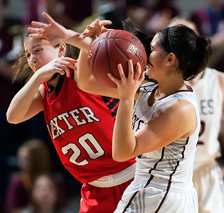 BANGOR, Maine -- 02/25/2017 -- Dexter's Ashley Reynolds (left) tries to steal the ball from George Stevens Academy's Julianna Allen during their Class C girls basketball championship game at the Cross Insurance Center in Bangor Saturday. Ashley L. Conti | BDN
