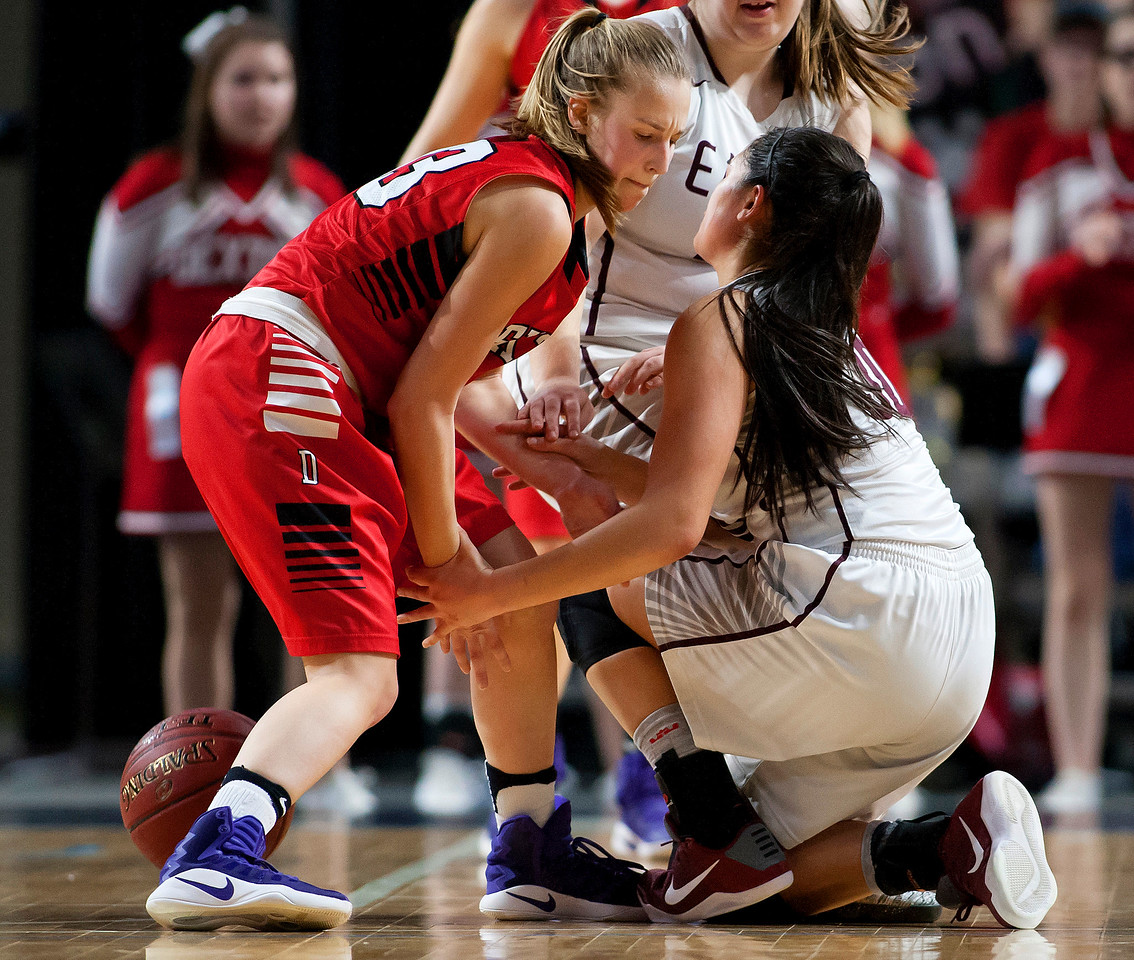 BANGOR, Maine -- 02/25/2017 -- Dexter's Abigail Webber (left) battles for a loose ball with George Stevens Academy's Julianna Allen during their Class C girls basketball championship game at the Cross Insurance Center in Bangor Saturday. Ashley L. Conti | BDN