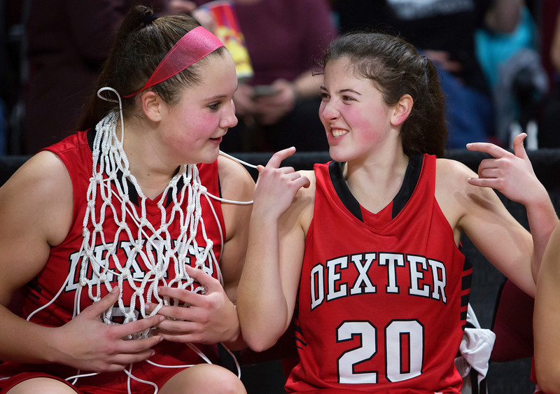 BANGOR, Maine -- 02/25/2017 -- Dexter's Ashley Reynolds (right) shows off her excitement to Dexter's Megan Peach after defeating George Stevens Academy during their Class C girls basketball championship game at the Cross Insurance Center in Bangor Saturday. Ashley L. Conti | BDN