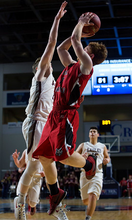 BANGOR, Maine -- 02/25/2017 -- Fort Fairfield's Ryan Player (right) tries to put a shot past George Stevens Academy's Taylor Schildroth during their Class C boys basketball championship game at the Cross Insurance Center in Bangor Saturday. Ashley L. Conti   BDN