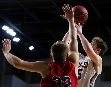 BANGOR, Maine -- 02/25/2017 -- George Stevens Academy's Taylor Schildroth (right) drives up for two past Fort Fairfield's Jared Harvey during their Class C boys basketball championship game at the Cross Insurance Center in Bangor Saturday. Ashley L. Conti   BDN