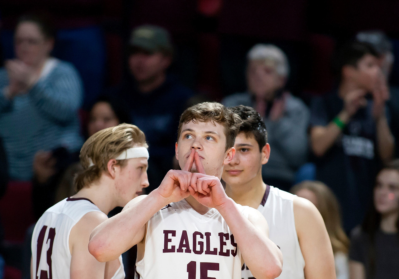 BANGOR, Maine -- 02/25/2017 -- George Stevens Academy's Taylor Schildroth puts his fingers to his lips while turning to the Fort Fairfield crowd during their Class C boys basketball championship game at the Cross Insurance Center in Bangor Saturday. Ashley L. Conti | BDN