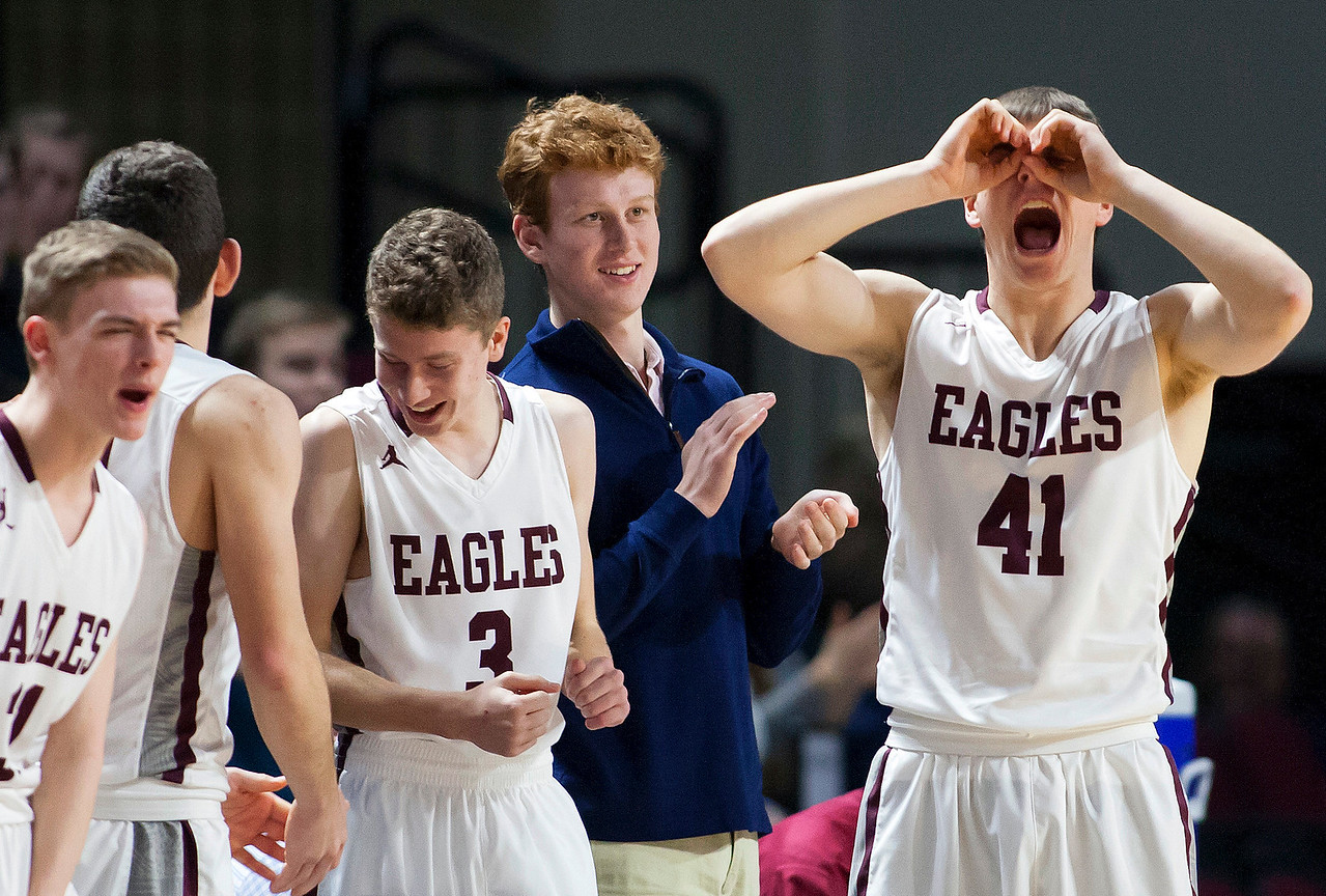 BANGOR, Maine -- 02/25/2017 -- George Stevens Academy's Tyler McKenney (right) motions with his hands after his team scored against Fort Fairfield during their Class C boys basketball championship game at the Cross Insurance Center in Bangor Saturday. Ashley L. Conti | BDN
