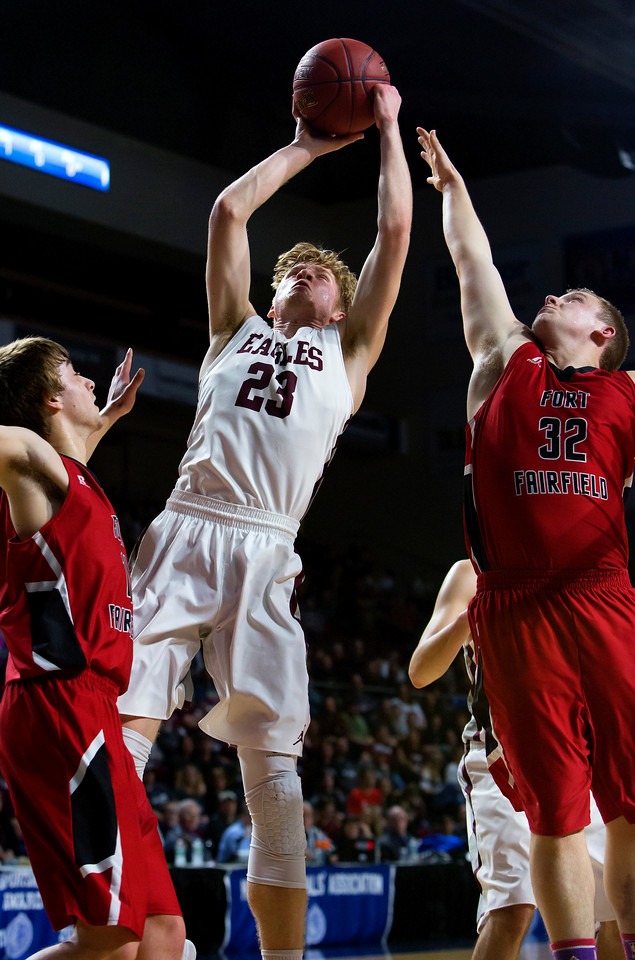 BANGOR, Maine -- 02/25/2017 -- George Stevens Academy's Maxwell Mattson (center) puts up a shot past Fort Fairfield's Christopher Giberson (left) and Fort Fairfield's Jared Harvey  during their Class C boys basketball championship game at the Cross Insurance Center in Bangor Saturday. Ashley L. Conti | BDN
