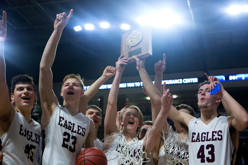 BANGOR, Maine -- 02/25/2017 -- George Stevens Academy celebrates after defeating Fort Fairfield during their Class C boys basketball championship game at the Cross Insurance Center in Bangor Saturday. Ashley L. Conti   BDN